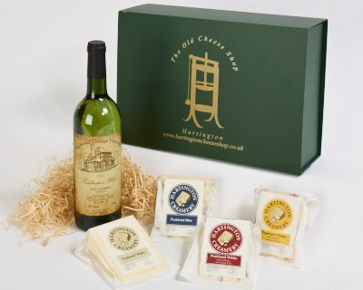 <p>This hamper box comes complete with a beautiful bottle of wine from the Sealwood Vineyard in Deryshire. Vines grown on their own vineyard produce a lovely wine. The cheeses are from the Hartington Creamery in the Parish of Hartington and are all award winning cheeses. The peakland Blue is a trophy winner at Bakewell Show for best blue cheese and the Peakland White has just won silver for best new cheese at the British Cheese Awards. Also included are Peakland White with Smoked Tomato &amp; Garlic and our very moreish Peakland White with Cranberry &amp; Orange.</p>