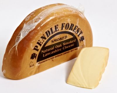 Produced at Sandhams dairy in Barton this is a traditional hard pressed Lancashire cheese. Naturally oak smoked in Sandhams own smoke house the cheese has a creamy texture of Lancashire combined with a sharp smoked taste.